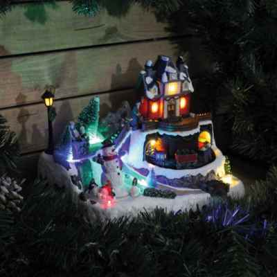 LED Christmas Village Scene with Turning Snowman
