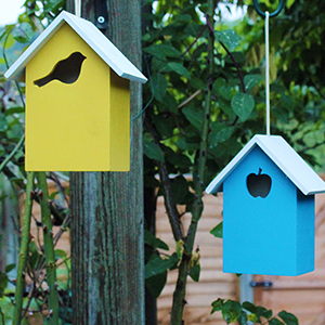 Yellow and Blue Wooden Bird Houses